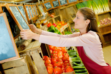 Woman working in a greengrocery