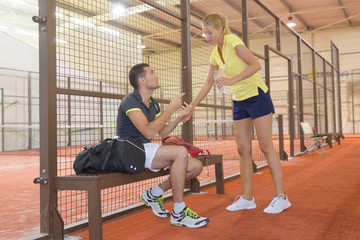 couple tennis players at indoor tennis club