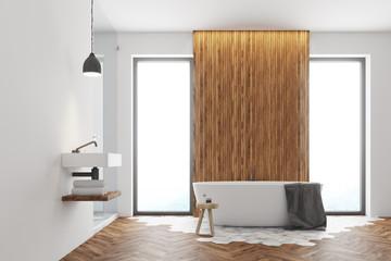 White and dark wooden bathroom interior