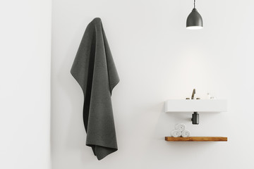 White bathroom sink and a towel