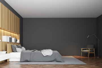 Gray and wooden bedroom interior, side