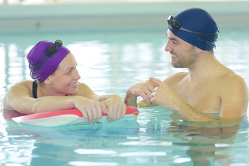 couple swimming in the pool