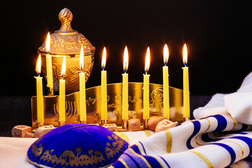 jewish holiday Hanukkah background with menorah traditional candelabra and burning candles