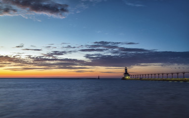 Lighthouse at sunset sky on Lake Michigan, Indiana, USA