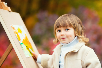 Autumn Baby Girl Drawing in Fall Leaves Park, Little Kid Painting, Children Creativity.