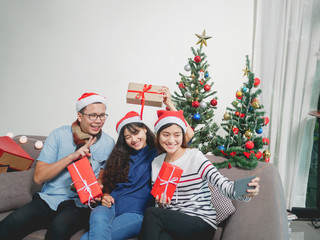 Beautiful Asian girlfriends take photos for Christmas or New Year.