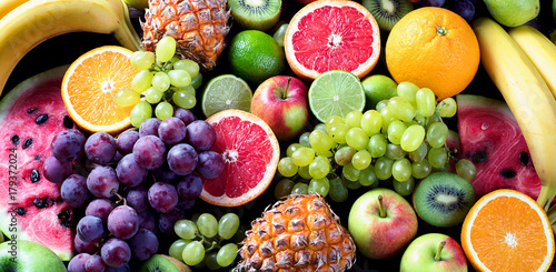 Wall mural Organic fruits. Healthy eating concept. Top view