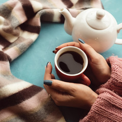 warm and comfy concept. Woman drinks hot tea on a cold autumn day to treat cold or flu