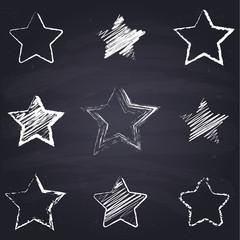 Chalk drawn star. Geometric figures on chalkboard background.