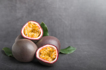 passion fruit on a grey stone table