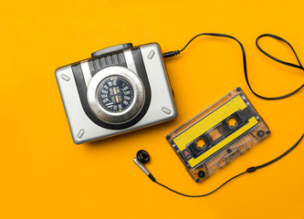 player and audio cassete on yellow background