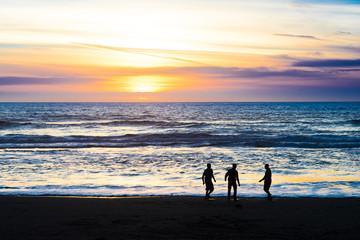 Three Men Enjoying Beach Sunset