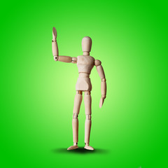 Wooden Mannequin friendly wave hand with greeting on green background