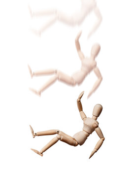 Wooden Mannequin falling down on white background. Accident and safety first concept