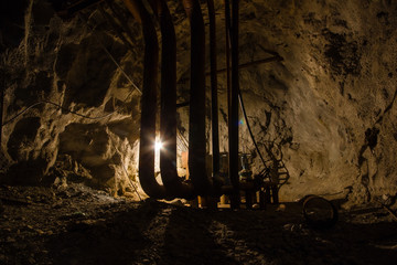 Underground mine shaft iron ore tunnel gallery with pipes