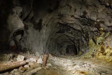 Undeground tunnel gallery in abamdoned mine shaft