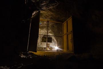 Massive gate in the copper ore mine shaft tunnel gallery