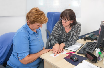 Office work session attended by two mature women