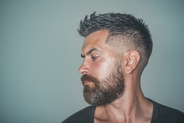 Man with bearded face profile and stylish hair