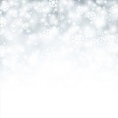 White winter background with snowflakes.