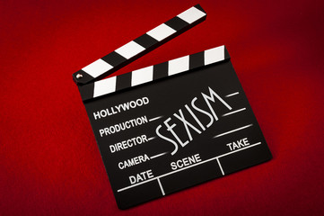 Sexism and sexual harassment in hollywood concept with clapper board representing the movie industry and the text Sexism