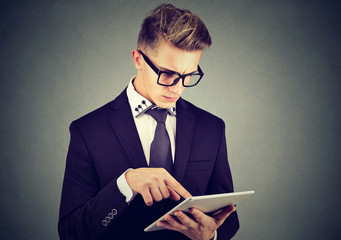 Young professional man using a tablet pc