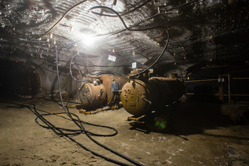 Underground mine shaft iron ore tunnel gallery with electrical transformer