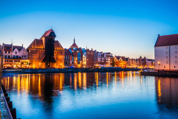 Gdansk at night with reflection in Motlawa river, Poland