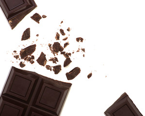 Broken chocolate bar isolated on white