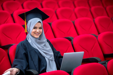 Girl wearing hijab graduation concept