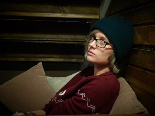 Young stylish woman wearing hipster hat and glasses