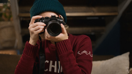 Young hipster woman making photos with photo camera