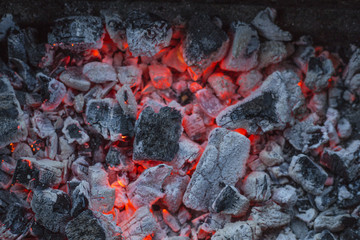 red-hot pieces of coal and the flames in the brazier for cooking food