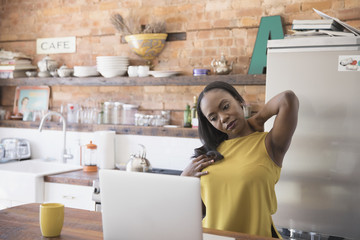 Businesswoman stretching while working at home