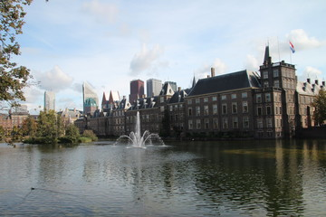 Dutch parliament building Binnenhof at the Hofvijver with fountainb