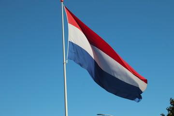 Dutch flag in the blue sky