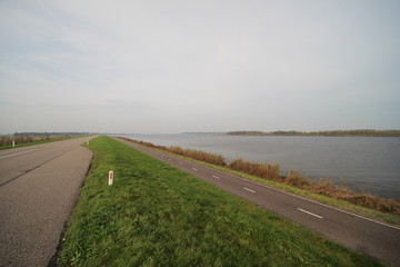 Dyke with cycle road along the Ketelmeer, The Netherlands