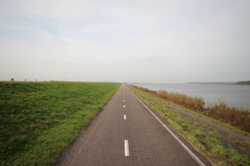 Road on a dike along the Ketelmeer, flevoland in Netherlands