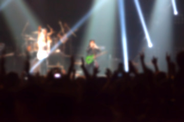 blurry image background of musicians rock in big rock concert.