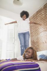 Woman balancing on her wife