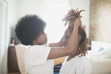 Woman adjusting her wife's hair