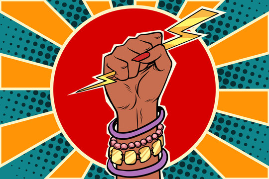 Girl power lightning in the fist. African woman