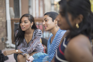 Young women talking at a party