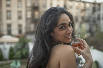Young woman with a glass of wine at a party