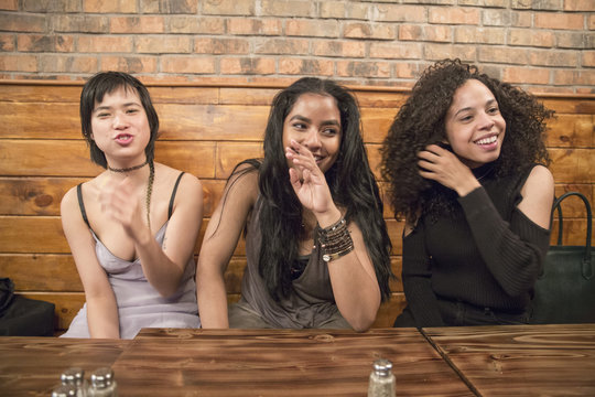 Friends at a restaurant in Queens, New York