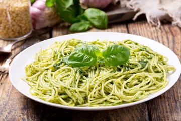 plate of pasta with pesto sauce
