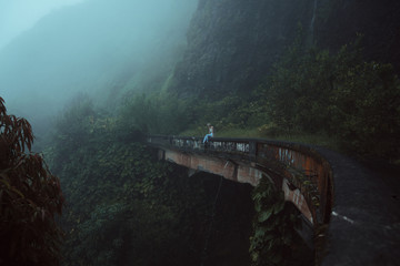 woman enjoying view from abandoned bridge