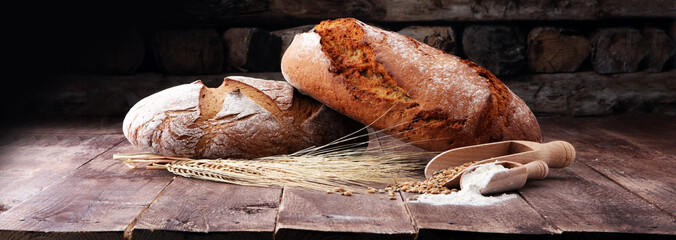 Freshly baked bread and flour in a bakery concept set.