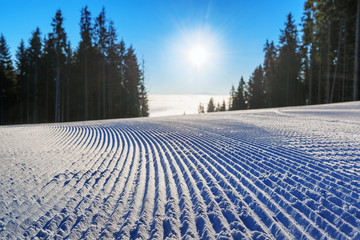 Fresh groomed ski slope in the morning
