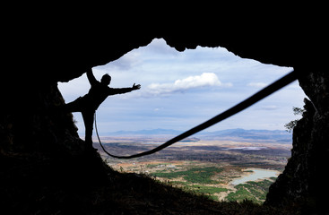 climbing with rope in the cave